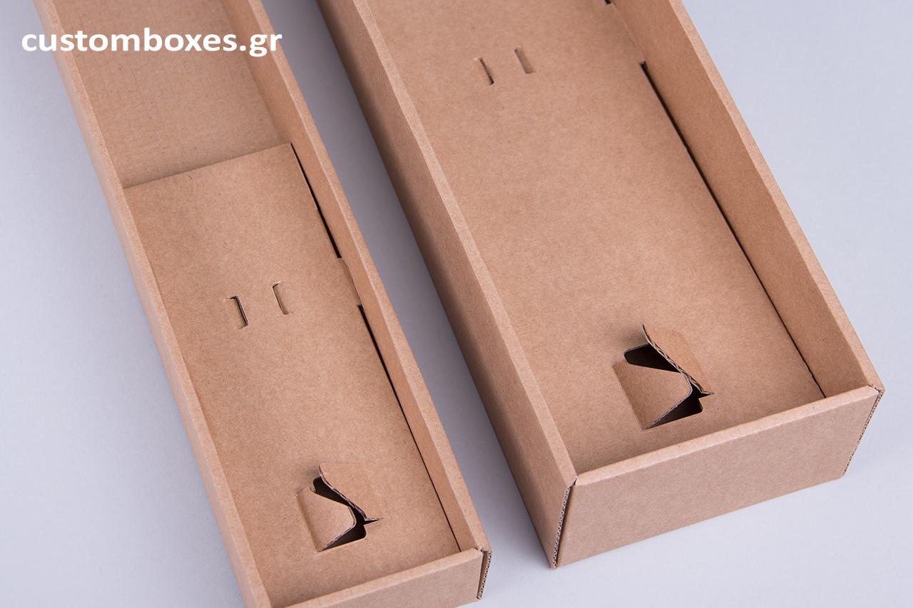 Πρόκειται για ελληνικά, πρωτοποριακά προϊόντα, καθώς τα κουτιά σχεδιάζονται και κατασκευάζονται εξ' ολοκλήρου στην Ελλάδα από την εταιρεία Συσκευασίες Newman