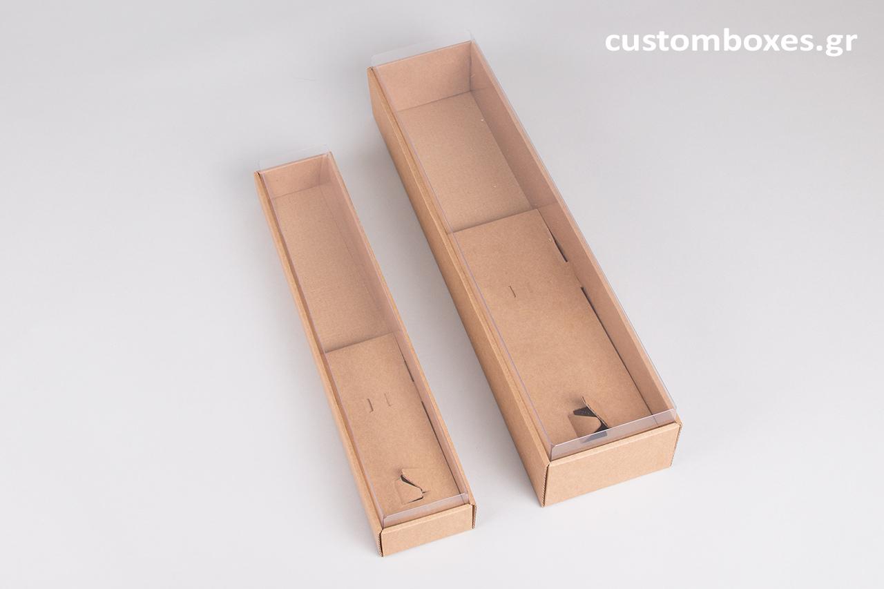 Χάρτινα, οικολογικά, κουτιά Kraft, σχεδιασμένα για πασχαλινές λαμπάδες, με διαφανές καπάκι.
